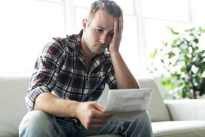 Shocked man having financial problems